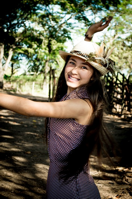 happy, strong girl in hat